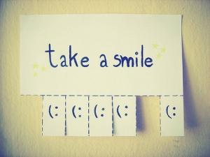 Coge una sonrisa, el mundo te espera